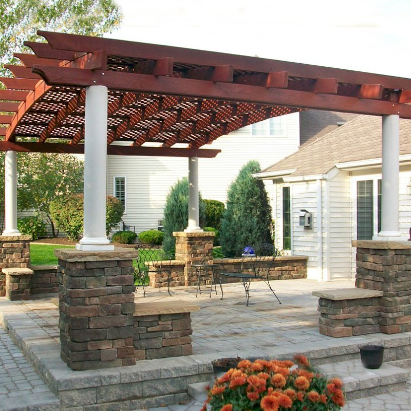 Arched Pergola Kits (Options: 15' L x 20' Arc W, Mature Redwood, Unattached, No Electrical Wiring Trim, Arched Roof with Lattice Panels, 4 Post Anchor Kit for Stone, No ceiling Fan Base, No Privacy Panels, No Curtain Rods, 10' Post Height, Cherry Stain Premium Sealant). Photo Courtesy of Mr. Gary B. of Depew, WN.