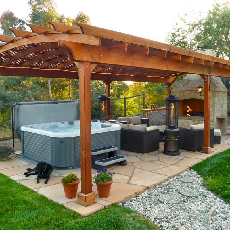 Arched Pergola Kits (Options: 35' L x 18' Arc W, California Redwood, Unattached, Electrical Wiring Trim for 1 Post, Arched Roof with Lattice Panels, 6 Post Anchor Kit for Stone, No Ceiling Fan Base, No Privacy Panels, No Curtain Rods, 9' Post Height, Transparent Premium Sealant). Photo courtesy of Mark Strider of Danville CA.