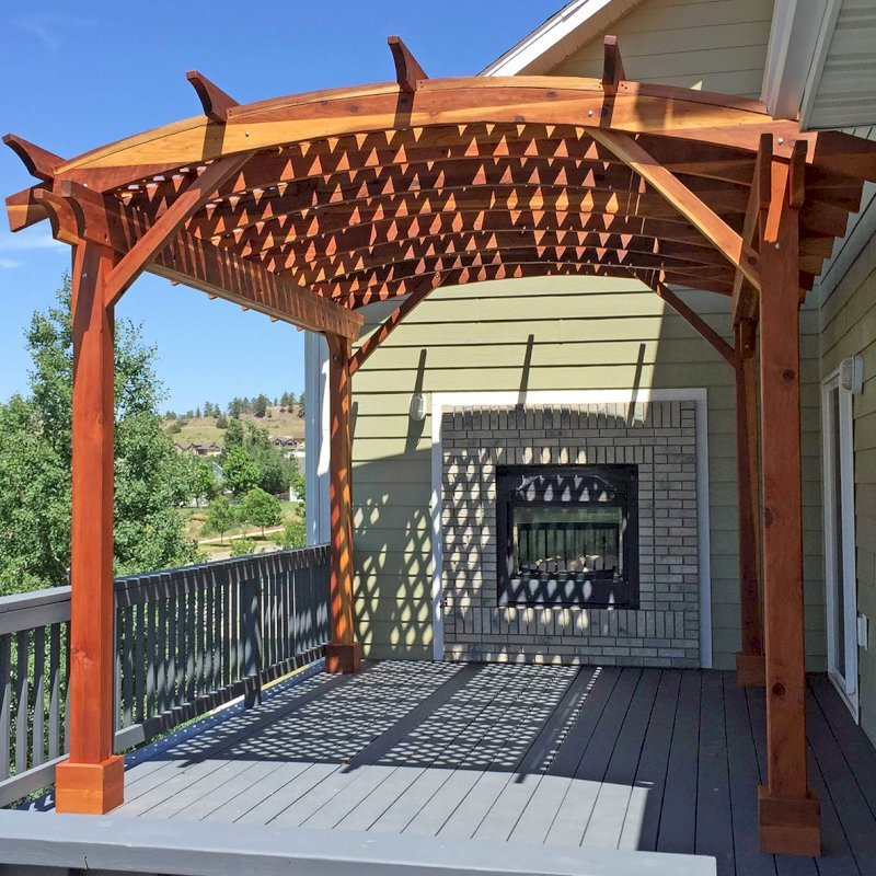 Arched Pergola Kits (Options: 16' L x 12' Arc W, California Redwood, No Electrical Wiring Trim, Arched Roof with Lattice Panels, 4 Post Anchor Kit for Wood, No Ceiling Fan Base, with No Privacy Panels, No Curtain Rods, Transparent Premium Sealant). Photo Courtesy of B. McPherson of Billings, MT.