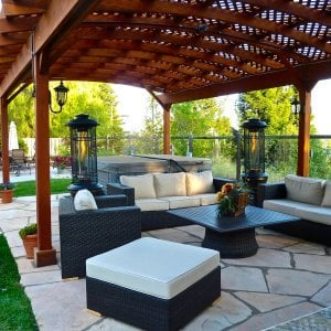 Arched Pergola Kits (Options: 35' L x 18' Arc W, Redwood, Unattached, Electrical Wiring Trim for 1 Post, Arched Roof with Lattice Panels, 6 Post Anchor Kit for Stone, No Ceiling Fan Base, No Privacy Panels, No Curtain Rods, 9' Post Height, Transparent Premium Sealant). Photo courtesy of Mark Strider of Danville CA.