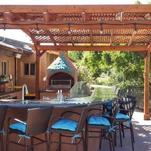 Arched Pergola Kits (Options: 15' L x 15' Arc W, Old-Growth Redwood, Unattached, Electrical Wiring Trim for 2 Posts, Arched Roof with Lattice Panels, 4 Post Anchor Kit for Stone, 1 Ceiling Fan Base, No Privacy Panels, No Curtain Rods, 9' Post Height, Transparent Premium Sealant). Photo Courtesy of Dennis Landall of Arcadia, CA.