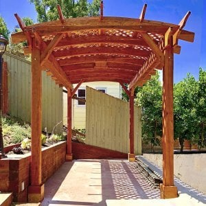 Arched Pergola Kit (Options: 16' L x 10' Arc W, Redwood, Electrical Wiring Trim Kit for 1 Post, 4 Post Anchor Kit for Concrete, 1 Ceiling Fan Base, No Privacy Panels, No Curtain Rods, 9' Post Height, Transparent Premium Sealant). Photo Courtesy of D. Barreras of South Pasadena, CA.