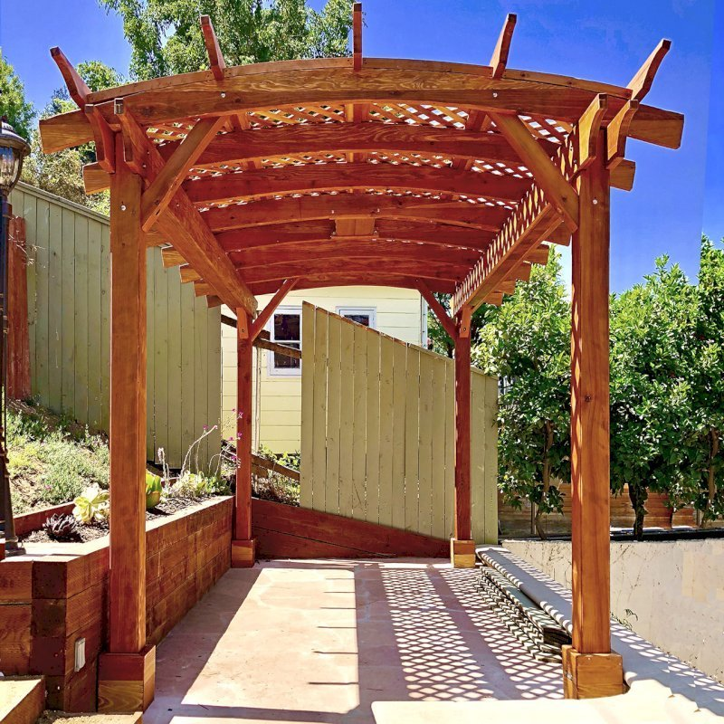 Arched Pergola Kit (Options: 16' L x 10' Arc W, California Redwood, Electrical Wiring Trim Kit for 1 Post, 4 Post Anchor Kit for Concrete, 1 Ceiling Fan Base, No Privacy Panels, No Curtain Rods, 9' Post Height, Transparent Premium Sealant). Photo Courtesy of D. Barreras of South Pasadena, CA.