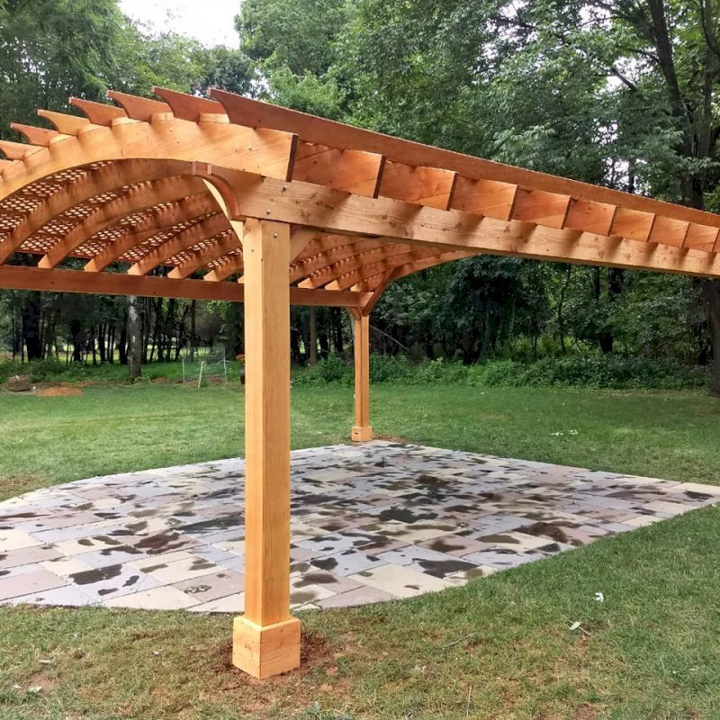 Arched Pergola Kit (Options: 24' L x 24' Arc W, Douglas-fir, Electrical Wiring Trim Kit for 2 Posts, 4 Post Anchor Kit for Gale-Wind, 1 Ceiling Fan Base, No Privacy Panels, No Curtain Rods, 9.5' Post Height, Transparent Premium Sealant). Photo Courtesy of D. Juiliano of Randolph, NJ.
