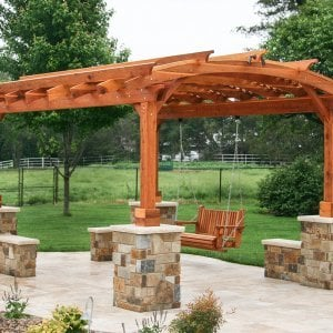 Arched Pergola Kits (Options: 16' L x 12' Arc W, Redwood, Unattached, Electrical Wiring Trim for 1 Post, Arched Roof with Lattice Panels, 4 Post Anchor Kit for Concrete, No Ceiling Fan Base, No Privacy Panels, No Curtain Rods, 9' Post Height, Transparent Premium Sealant). With a Bench Swing by Custom Request. Photo Courtesy of Doug Kirkland of Valley Center, Kansas.