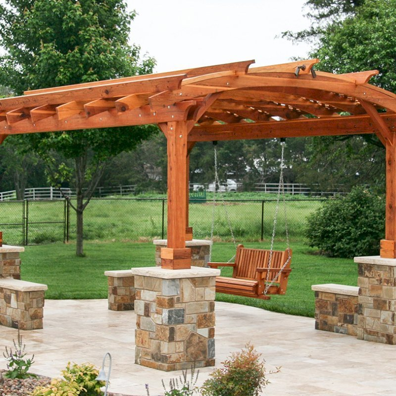 Arched Pergola Kits (Options: 16' L x 12' Arc W, California Redwood, Unattached, Electrical Wiring Trim for 1 Post, Arched Roof with Lattice Panels, 4 Post Anchor Kit for Concrete, No Ceiling Fan Base, No Privacy Panels, No Curtain Rods, 9' Post Height, Transparent Premium Sealant). With a Bench Swing by Custom Request. Photo Courtesy of Doug Kirkland of Valley Center, Kansas.