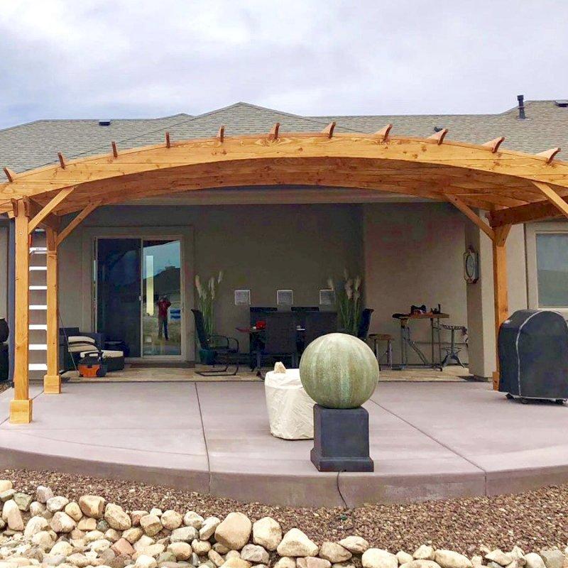 Arched Pergola Kit (Options: 10' L x 24' Arc W, Douglas-fir, No Electrical Wiring Trim, 4 Post Anchor Kit for Concrete, No Ceiling Fan Base, No Privacy Panels, No Curtain Rods, 9' Post Height, Transparent Premium Sealant). Photo Courtesy of H. Dolan of Prescott, AZ.