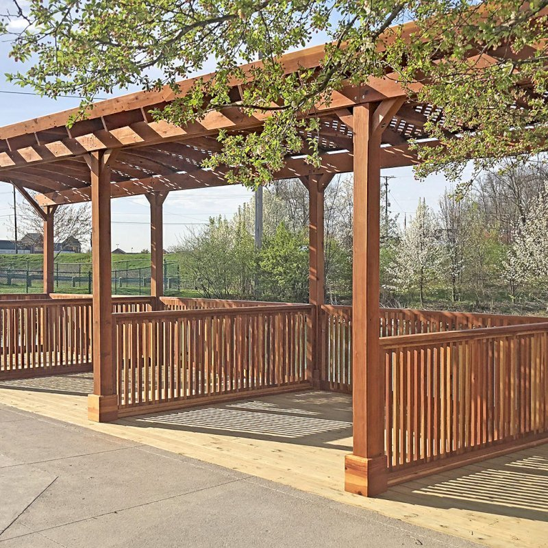 Arched Pergola Kits (Options: 40' L x 14' Arc W, California Redwood, No Electrical Wiring Trim, Arched Roof with Lattice Panels, 10 Post Anchor Kit for Wood, 2 Ceiling Fan Bases, No Curtain Rods, Transparent Premium Sealant). Privacy stalls added by custom request. Photo Courtesy of D. Hatcher of Lewis Center, OH.