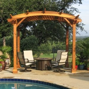 Arched Pergola Kits (Options: 12' x 10' Arc W, Redwood, Unattached, No Electrical Wiring Trim, Arched Roof with Lattice Panels, 4 Post Anchor Kit for Stone, No Ceiling Fan Base, No Privacy Panels, No Curtain Rods, 9' Post Height, Transparent Premium Sealant). Photo Courtesy of Mr John & Vicky Lewis of Wimberley, TX.
