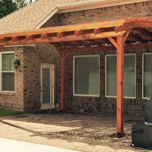 Arched Pergola Kits (Options: 18' L x 15' Arc W, Mature Redwood, Unattached, No Electrical Wiring Trim, Arched Roof with Lattice Panels, 4 Post Anchor Kit for Stone, No Ceiling Fan Base, No Privacy Panels, No Curtain Rods, 10' Post Height, Transparent Premium Sealant). Photo Courtesy of Andrew Snoddy of Little River, South Carolina.
