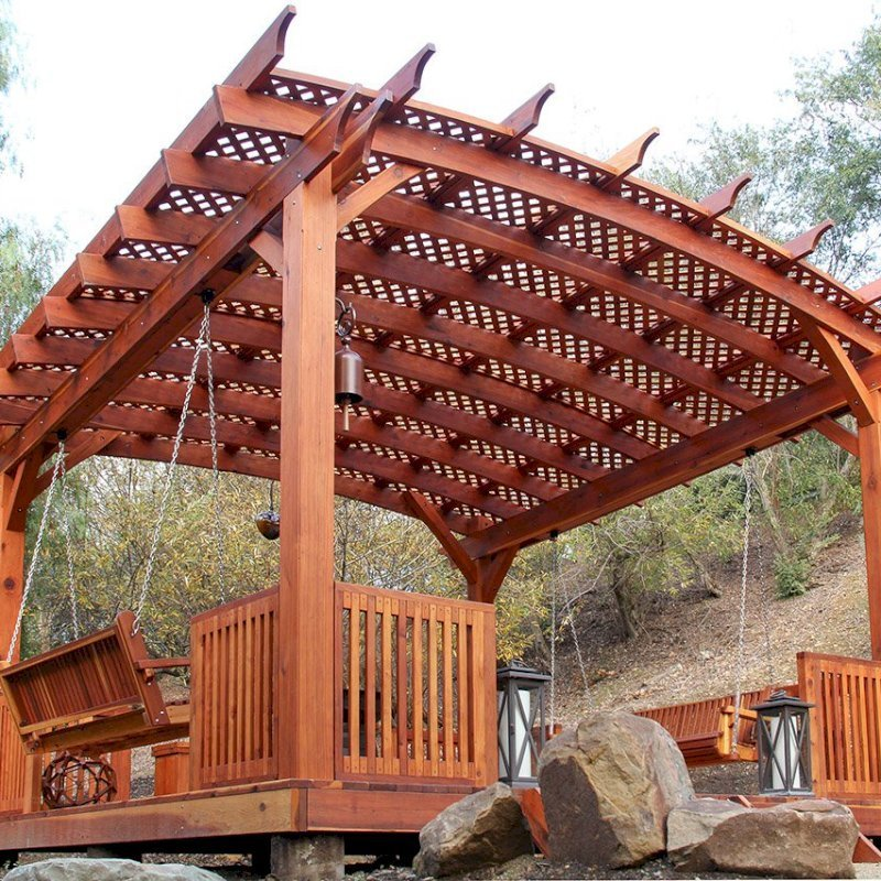 Arched Pergola Kits (Options: 18' x 18', Mature Redwood, 3 Degree Roof Slope by Custom Request, with Lattice Panels, with Deck and Railing by Custom Request, with a Bench Swing Seat). Photo Also Shows a Custom Storage Bench. Photo Courtesy of Bob P. of Westlake Village, CA.