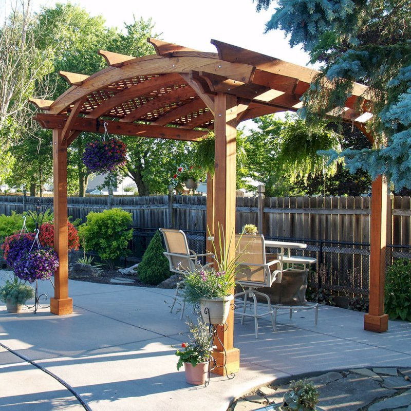 Arched Pergola Kits (Options: 12' L x 12' Arc W, Mature Redwood, Unattached, No Electrical Wiring Trim, Arched Roof with Lattice Panels, 4 Post Anchor Kit for Stone, No Ceiling Fan Base, No Privacy Panels, No Curtain Rods, 9' Post Height, Transparent Premium Sealant). Photo Courtesy of Jim Beatty of North Tonawanda, NY.