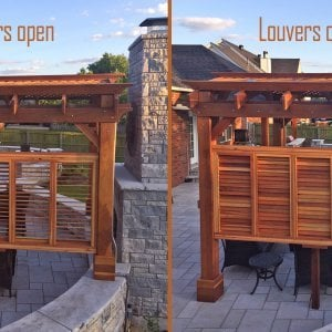 Arched Pergola Kit (Options: 12' L x 12' Arc W, Redwood, No Electrical Wiring Trim, Arched Roof with Lattice Panels, 4 Post Anchor Kit for Concrete, 1 Ceiling Fan Base, 1 Louver Privacy Panel, No Curtain Rods, Transparent Premium Sealant, 2 Posts Wrapped in Masonry, 8 x 8 Posts by Custom Request). Photo Courtesy of S. Hunter of Fort Smith, AR.