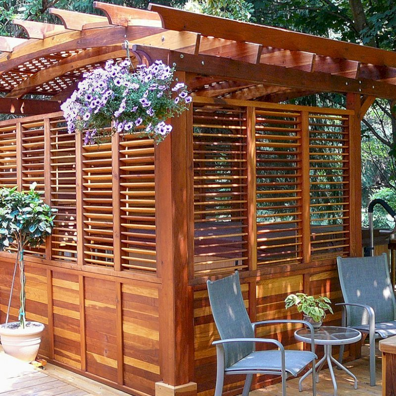 Arched Pergola Kits (Options: 16' L x 14' Arc W, With Wall Panel Louver Style, California Redwood, Unattached, No Electrical Wiring Trim, Arched Roof with Lattice Panels, 4 Post Anchor Kit for Stone, No Ceiling Fan Base, Privacy Panels, No Curtain Rods, 9' Post Height, Transparent Premium Sealant). Photo Courtesy of George Jackson of Commerce Township,  Michigan.