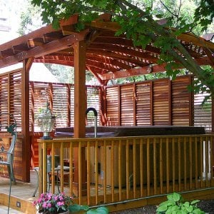 Arched Pergola Kits (Options: 16' L x 14' Arc W, Redwood, Unattached, No Electrical Wiring Trim, Arched Roof with Lattice Panels, 4 Post Anchor Kit for Stone, No Ceiling Fan Base, Privacy Panels, No Curtain Rods, 9' Post Height, Transparent Premium Sealant). Photo Courtesy of George Jackson of Commerce Township,  Michigan.