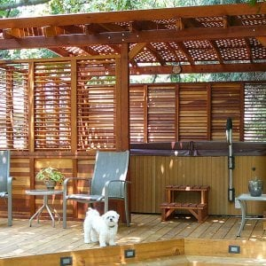 Arched Pergola Kits (Options: 16' L x 14' Arc W, Redwood, Unattached, No Electrical Wiring Trim, Arched Roof with Lattice Panels, 4 Post Anchor Kit for Stone, No Ceiling Fan Base, Privacy Panels & Louvers, No Curtain Rods, 9' Post Height, Transparent Premium Sealant). Photo Courtesy of George Jackson of Commerce Township, Michigan.