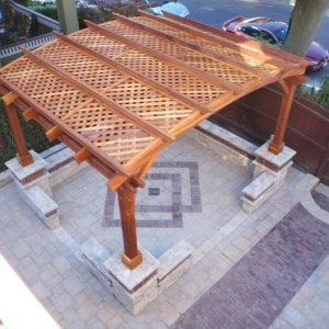 Arched Pergola Kits (Options: 12' L x 14' Arc W, Redwood, Unattached, No Electrical Witing Trim, Arched Roof with Lattice Panels, 4 Post Anchor Kit for Stone, No Ceiling Fan Base, No Privacy Panels, No Curtain Rods, 9' Post Height, Transparent Premium Sealant). Photo Courtesy of Mr. Gary Benson of Depew, NY. Brick work done around posts after installation.