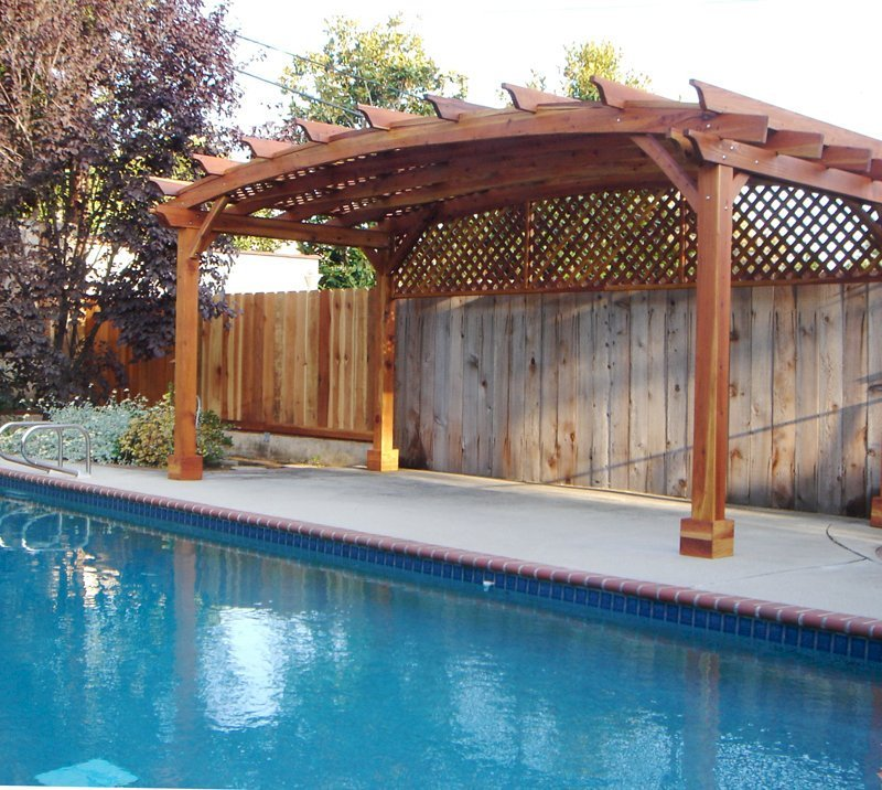 Arched Pergola Kits (Options: 10' L x 20' Arc W, California Redwood, Unattached, No Electrical Wiring Trim, Arched Roof with Lattice Panels, 4 Post Anchor Kit for Stone, No Ceiling Fan Base, 1 Privacy Panel, No Curtains Rods, 9' Post Height, Transparent Premium Sealant).