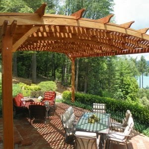 Arched Pergola Kits (Options: 20' L x 18' Arc W, Mature Redwood, Unattached, No Electrical Wiring Trim, Arched Roof with Lattice Panels, 4 Post Anchor kit for Stone, No Ceiling Fan Base, No Privacy Panels, No Curtain Rods, 10' Post Height, Transparent Premium Sealant). Photo Courtesy of Edward G. of Nevada City, CA.