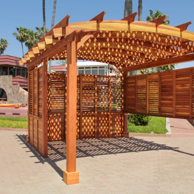 Arched Pergola Kits (Options: 16' L x 14' Arc W, California Redwood, Unattached, No Electrical Wiring Trim, Arched Roof with Lattice Panels, 4 Post Anchor Kit for Stone, No Ceiling Fan Base, Privacy Panels & Louvers, No Curtain Rods, 9' Post Height, Transparent Premium Sealant). Photo Courtesy of George Jackson of Commerce Township, Michigan.