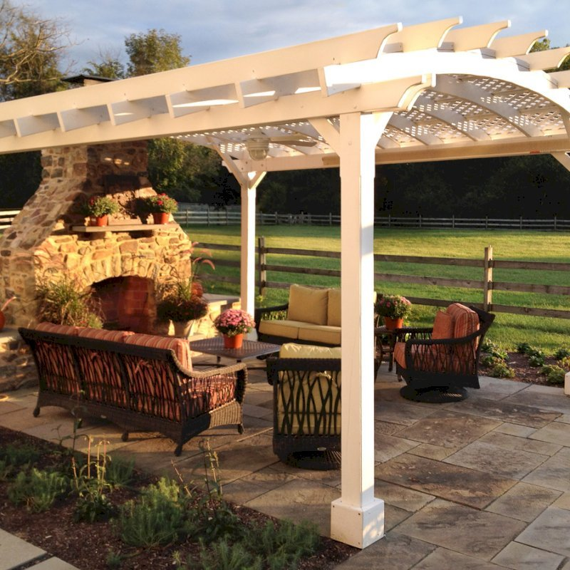 Arched Pergola Kits (Options: 18' L x 16' Arc W, California Redwood, Unattached, Electrical Wire Trim for 1 Post, Arched Roof with Lattice Panels, 4 Post Anchor Kit for Stone, Ceiling Fan Base, No Privacy Panels, No Curtain Rods, 9' Post Height, Off-White Oil-Based Primer). Photo Courtesy of Robert Stover of Center Valley, Pennsylvania.