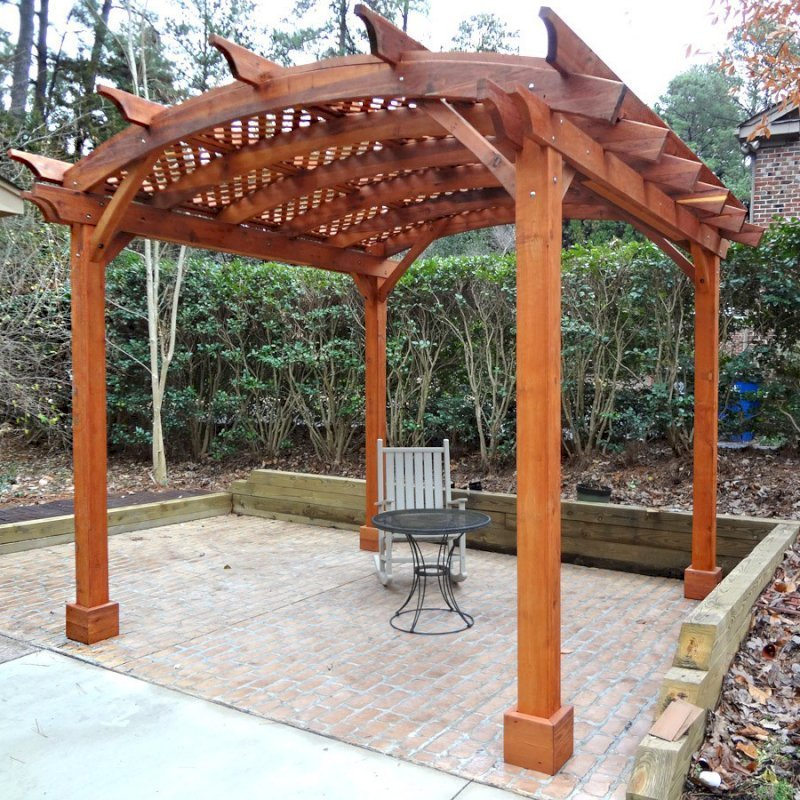 Arched Pergola Kits (Options: 12' L x 12' Arc W, Mature Redwood, Unattached, No Electrical Wiring Trim, Arched Roof with Lattice Panels, 4 Post Anchor Kit for Stone, No Ceiling Fan Base, No Privacy Panels, No Curtain Rods, 9' Post Height, Transparent Premium Sealant). Photo courtesy of Reuben Prichard of Raleigh, North Carolina.
