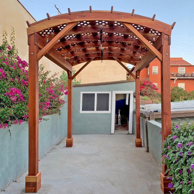 Arched Pergola Kit (Options: 12' L x 9' Arc W, California Redwood, No Overhangs by Custom Request, No Electrical Wiring Trim Kit, No Fan Base, No Privacy Panels, Transparent Premium Sealant). Photo Courtesy of R. Rabinov of Ventura, California.