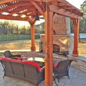 Arched Pergola Kit (Options: 12' L x 12' Arc W, Redwood, No Electrical Wiring Trim, Arched Roof with Lattice Panels, 4 Post Anchor Kit for Concrete, 1 Ceiling Fan Base, No Privacy Panels, No Curtain Rods, Transparent Premium Sealant, 2 Posts Wrapped in Masonry, 8 x 8 Posts by Custom Request). Photo Courtesy of S. Hunter of Fort Smith, AR.