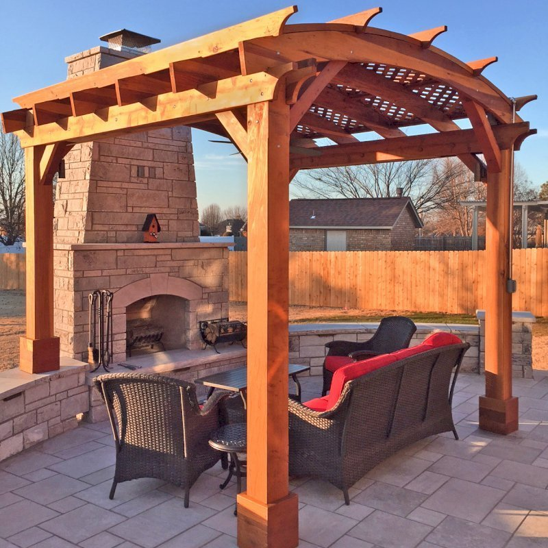 Arched Pergola Kit (Options: 12' L x 12' Arc W, California Redwood, No Electrical Wiring Trim, Arched Roof with Lattice Panels, 4 Post Anchor Kit for Concrete, 1 Ceiling Fan Base, No Privacy Panels, No Curtain Rods, Transparent Premium Sealant, 2 Posts Wrapped in Masonry, 8 x 8 Posts by Custom Request). Photo Courtesy of S. Hunter of Fort Smith, AR.