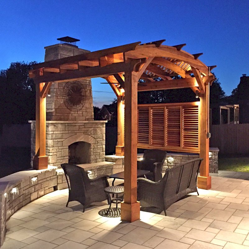Arched Pergola Kit (Options: 12' L x 12' Arc W, California Redwood, No Electrical Wiring Trim, Arched Roof with Lattice Panels, 4 Post Anchor Kit for Concrete, 1 Ceiling Fan Base, 1 Louver Privacy Panel, No Curtain Rods, Transparent Premium Sealant, 2 Posts Wrapped in Masonry, 8 x 8 Posts by Custom Request). Photo Courtesy of S. Hunter of Fort Smith, AR.