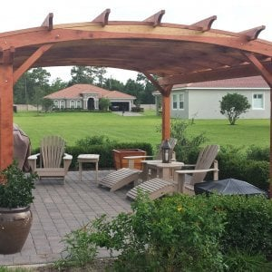 Arched Pergola Kits (Options: 16' L x 14' Arc W, Redwood, Unattached, No Electrical Wiring Trim, Arched Roof with Lattice Panels, 4 Post Anchor Kit for Stone, No Ceiling Fan Base, No Privacy Panels, No Curtain Rods, 9' Post Height, Transparent Premium Sealant). Photo Courtesy of Scott and Elizabeth Tribbey of Miami, FL.