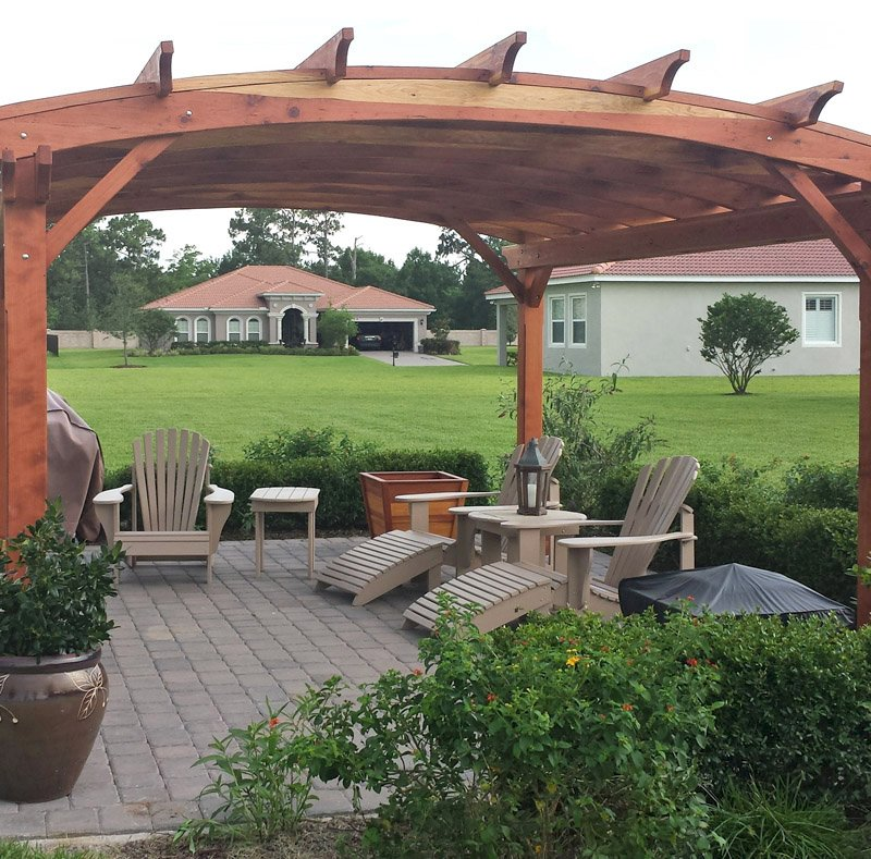 Arched Pergola Kits (Options: 16' L x 14' Arc W, California Redwood, Unattached, No Electrical Wiring Trim, Arched Roof with Lattice Panels, 4 Post Anchor Kit for Stone, No Ceiling Fan Base, No Privacy Panels, No Curtain Rods, 9' Post Height, Transparent Premium Sealant). Photo Courtesy of Scott and Elizabeth Tribbey of Miami, FL.
