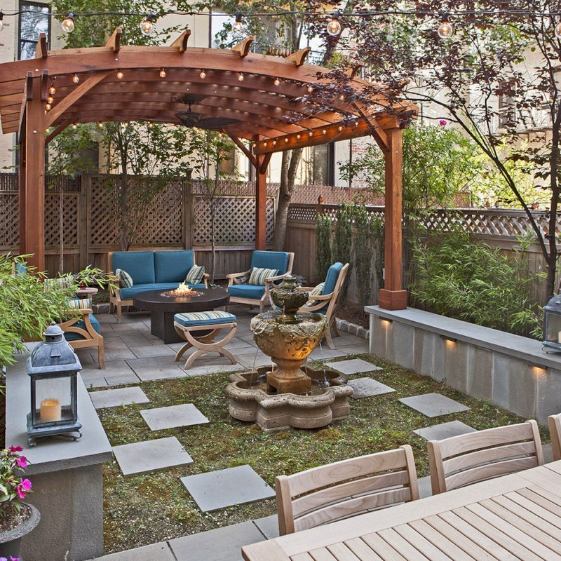 Arched Pergola Kits (Options: 14' L x 14' Arc W, Mature Redwood, 2 Electrical Wiring Trims, Arched Roof with Lattice Panels, 4 Post Anchor Kit for Concrete, 1 Ceiling Fan Base, No Privacy Panels, No Curtain Rods, Transparent Premium Sealant). Photo Courtesy of Steve Walkowiak of Hoboken, NJ.