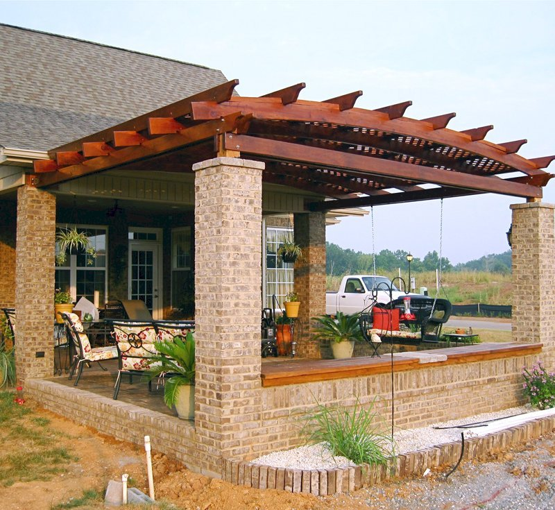 Arched Pergola Kits (Options: 14' L x 18' Arc W, California Redwood, Attached,  No Electrical Wiring Trim, Arched Roof with Lattice Panels, 4 Post Anchor Kit for Stone, No Ceiling Fan Base, No Privacy Panel, No Curtain Rods, 9' Post Height, Transparent Premium Sealant).  Posts wrapped in masonry. Photo courtesy of Mr. Brandon Campbell of  Lenoir City, TN.