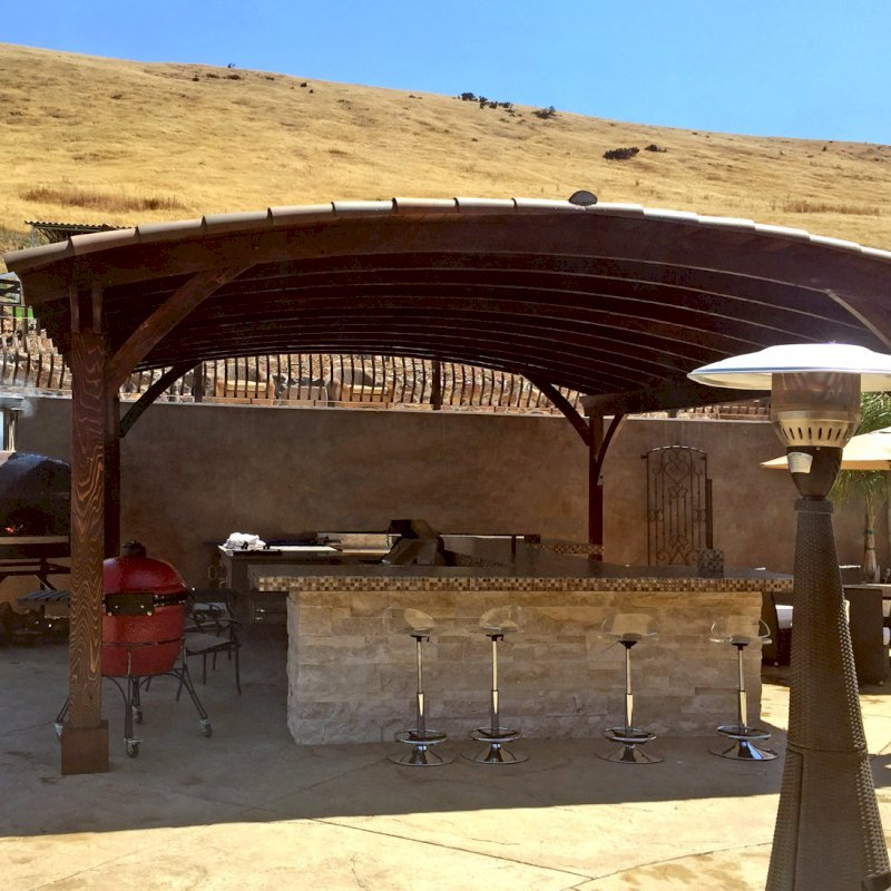 Arched Thick Timber Pavilion (Options: 24' L x 22' Arc W, California Redwood, No Electrical Wiring Trim, 4 Post Anchor Kit for Concrete, No Ceiling Fan Base, No Privacy Panel, No Curtain Rods, 10ft H, Transparent Premium Sealant).