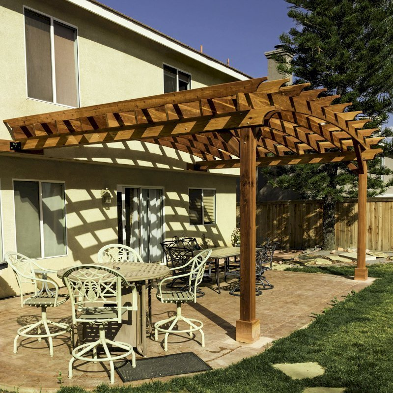 Attached Arched Pergola (Options: 20' L x 15' W, California Redwood, No Electrical Wiring Trim, Arched Roof without Lattice Panels, 2-Post Anchor Kit for Concrete, No Ceiling Fan Base, No Privacy Panels, No Curtain Rods, 10' Post Height, Transparent Premium Sealant). Photo Courtesy of C. Thompson of Corona, CA.