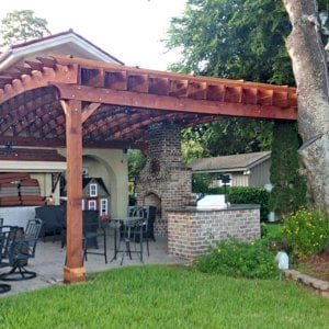 """Custom Attached Arched Pergola (Options: 22' L x 26' W, California Redwood, No Electrical Wiring Trim, Rafters at 18"""" and Slats at 18"""", 3-Post Anchor Kit for Hurricane, with Transparent Rain Guard, Ceiling Fan Base, No Privacy Panels, No Curtain Rods, 10' Post Height, Transparent Premium Sealant, Attached to Wall by Support Side, Arches are 2x12's by Custom Request). Photo Courtesy of M. Yocco of Hilton Head, South Carolina."""