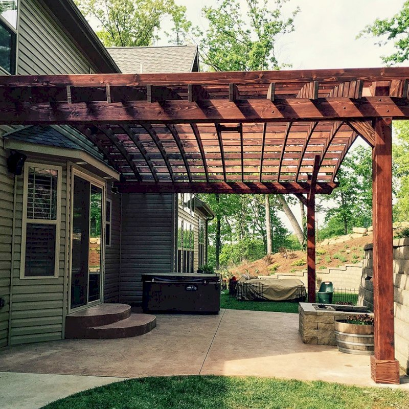 """Attached Arched Pergola (Options: 20' L x 26' W, Douglas-fir, No Electrical Wiring Trim, Rafters at 18"""" and Slats at 18"""", Widthwise Roof Support Timbers, 2-Post Anchor Kit for Concrete, Ceiling Fan Base, No Privacy Panels, No Curtain Rods, 11' Post Height, Coffee-Stain Premium Sealant). Photo Courtesy of Susanne Stephens of Eureka, Missouri."""