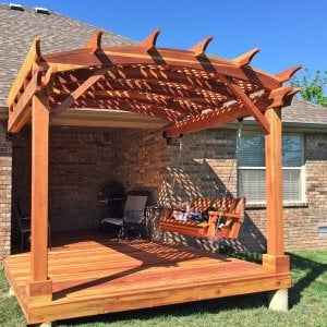 Attached Arched Pergola (Options: 10' x 10', California Redwood, No Electrical Wiring Trim, with Lattice Panels, 2-Post Anchor Kit for Concrete, No Ceiling Fan Base, No Privacy Options, No Curtain Rods, 9ft H, Transparent Premium Sealant) with Deck and Bench Swing by Custom Request. Photo Courtesy of Telory of A. of Springfield, MO..