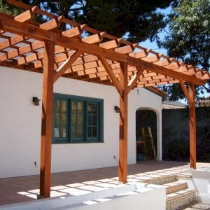 "Attached Garden Pergola (Options: 22' L x 10' W, Attached to Wall by Support Side, Mature Redwood, No Electrical Wiring Trim, Open Roof with Slats at 18"", 3-Post Anchor Kit for Concrete, Transparent Premium Sealant)."