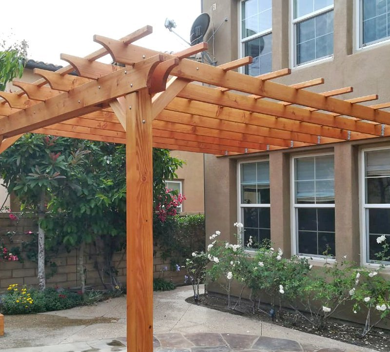 "Attached Garden Pergola (Options: 14' L x 15' W, Attached to Wall by Rafters Side, Douglas-fir, No Electrical Wiring Trim, 2-Post Anchor Kit for Gale-Wind, Open Roof with Slats at 18"", Rafters at 18"", No Post Decorative Trims, Transparent Premium Sealant). Photo Courtesy of H. Shang of Irvine, California."