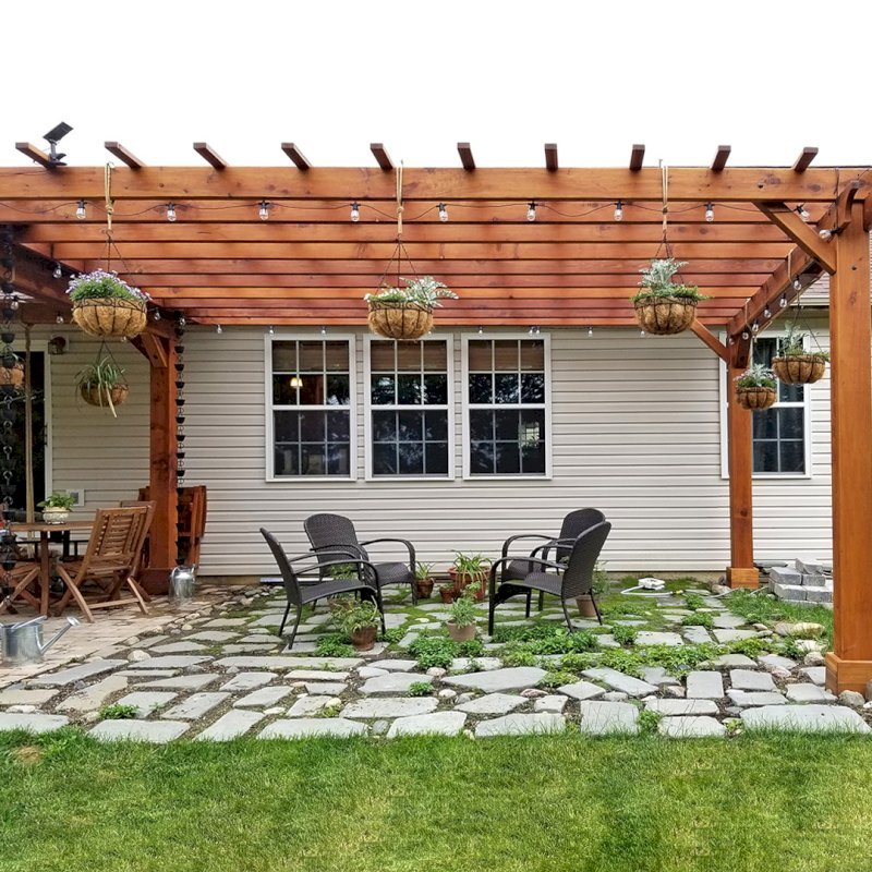 "Attached Garden Pergola (Options: 18' L x 14' W, California Redwood, No Electrical Wiring Trim, 2-Post Anchor Kit for Gale-Wind, Open Roof with Slats at 18"", Rafters at 18"", No Post Decorative Trims, Transparent Premium Sealant). Pergola Attached to a Del Norte Pavilion. Photo Courtesy of T. Lee of Noblesville, Indiana."