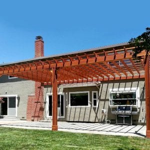 "Attached Garden Pergola (Options: 30' L x 15' W, Attached to Wall by Rafters Side, California Redwood, No Electrical Wiring Trim, 3-Post Anchor Kit for Gale-Wind, Open Roof with Slats at 18"", Rafters at 18"", No Post Decorative Trims, Transparent Premium Sealant). Photo Courtesy of Sean Canevaro of Milpitas, California."