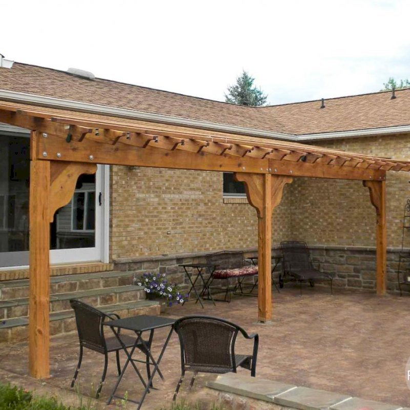 "Attached Garden Pergola (Options: 26' L x 12' W, Attached to Wall by Support Side, California Redwood, Custom Knee Braces, No Electrical Wiring Trim, Open Roof with Slats at 18"", Custom Anchor Kit, Transparent Premium Sealant)."