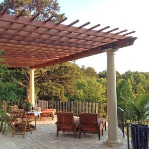 "Attached Garden Pergola (Options: 30' L x 14' W, Mature Redwood, No Electrical Wiring Trim, Open Roof with Slats at 12"", Posts Wrapped with Columns After Installation, Transparent Premium Sealant). Photo Courtesy of Casey Graybeal of Gainesville, Georgia."