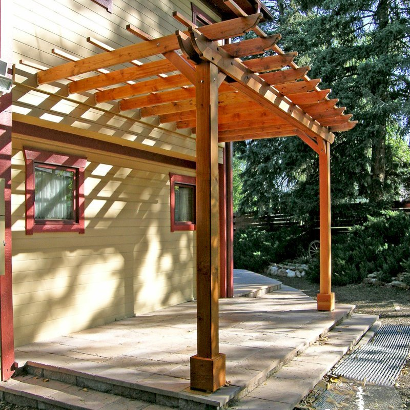 "Attached Garden Pergolas (Options: 15' x 8', Attached to Wall by Support Side, Douglas-fir, No Electrical Wiring Trim, Open Roof with Slats at 18"", 2-Post Anchor Kit for Stone, Transparent Premium Sealant)."