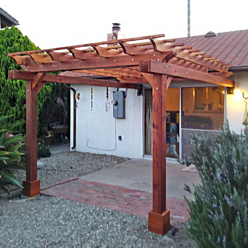 "Attached Garden Pergola (Options: 10' x 12', California Redwood, Open Roof with Slats at 12"", Rafters at 18"", 2-Post Anchor Kit for Concrete, Transparent Premium Sealant). Photo Courtesy of F. Butcher of Santa Barbara, CA."