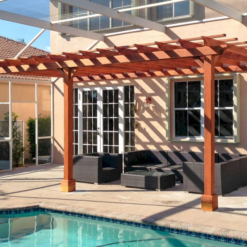"Attached Garden Pergola (Options: 25' L x 12' W, Attached to the Wall by Support Side, No Privacy Panels, California Redwood, No Electrical Wiring Trim, Open Roof with Slats at 18"", 3 Post Anchor Kit for Concrete, Transparent Premium Sealant)."