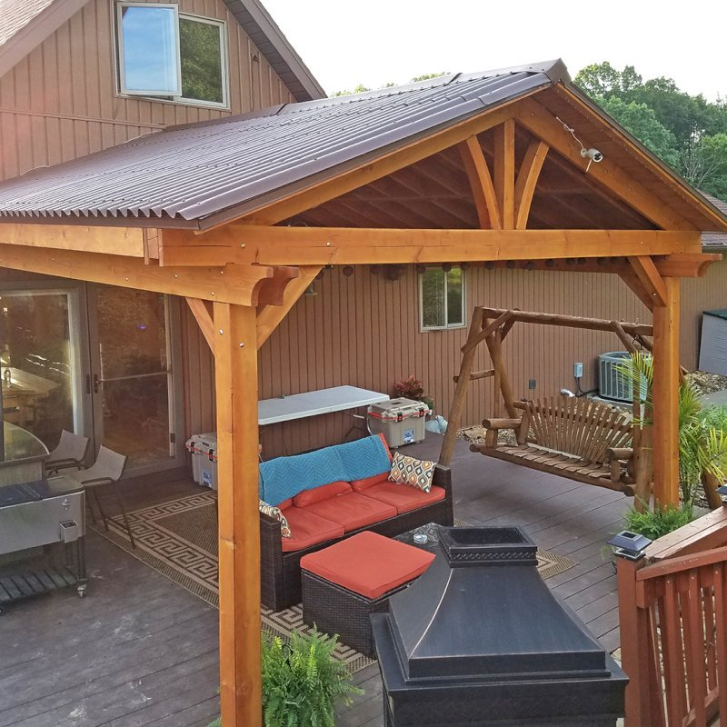 Attached Pavilion (Options: Del Norte roof style, 15'L x 15'W, Douglas-fir, 2-Post Anchor Kit for Wood, 2 Electrical Wiring Trims, 8.5 ft Posts Height, 1 Ceiling Fan Base, No Curtain Rods, No Privacy Panels, Transparent Premium Sealant). Photo Courtesy of M. McGinnis of Sarver, Pennsylvania.