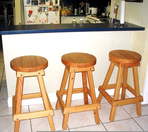 "3 Backless Bar Stools (Options: 36"" H, Douglas-fir, Round 15"" Diameter Seat, 4 Legs, No Engraving, Transparent Premium Sealant). Photo Courtesy of Norma and Pete Zayas of Miami, Florida."